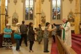 Parishioners line up to receive communion.
